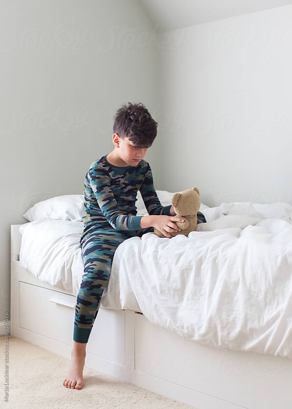 Boy and his bear in bed by Marta Locklear for Stocksy United