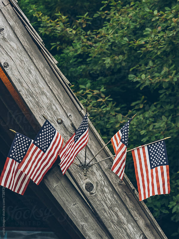 5 little usa flags on the wooden roof by yuanyuan xie for Stocksy United