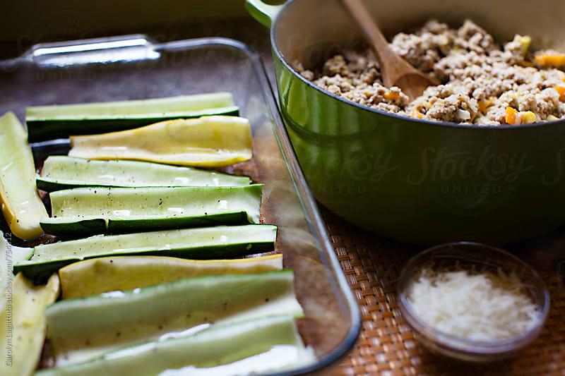 Ingredients for a stuffed zucchini recipe by Carolyn Lagattuta for Stocksy United