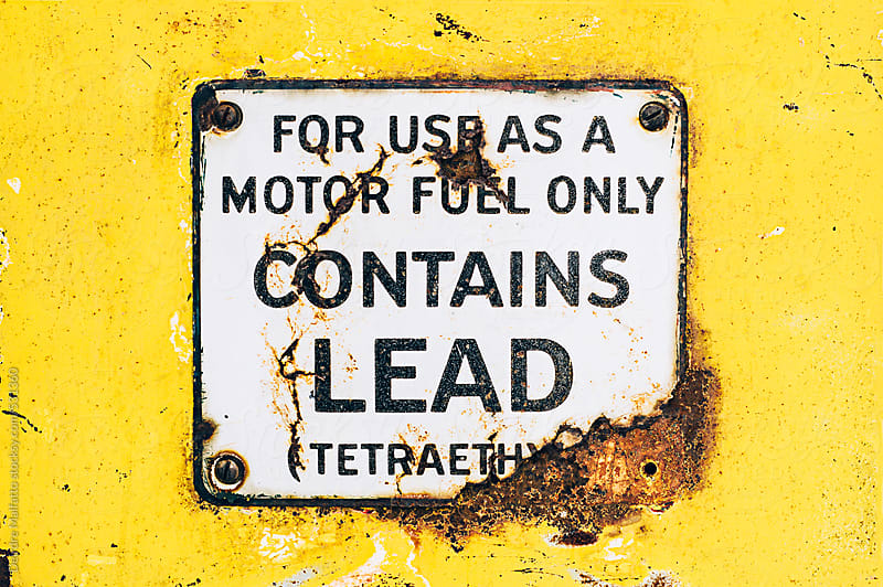 lead warning on gas pump by Deirdre Malfatto for Stocksy United