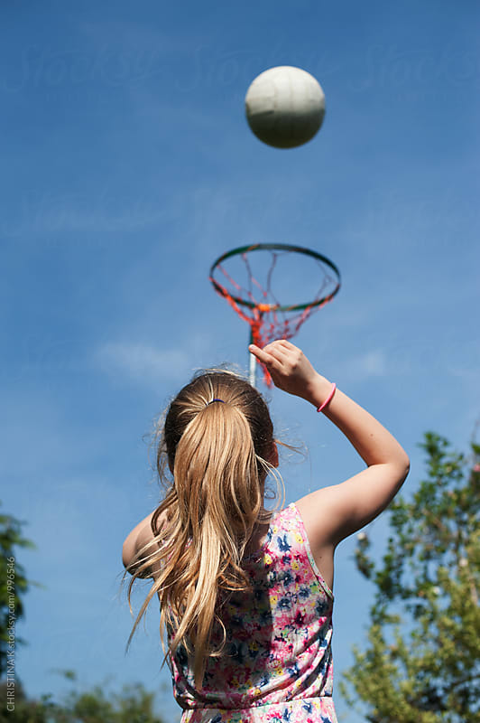 Girl playing netball by CHRISTINA K for Stocksy United
