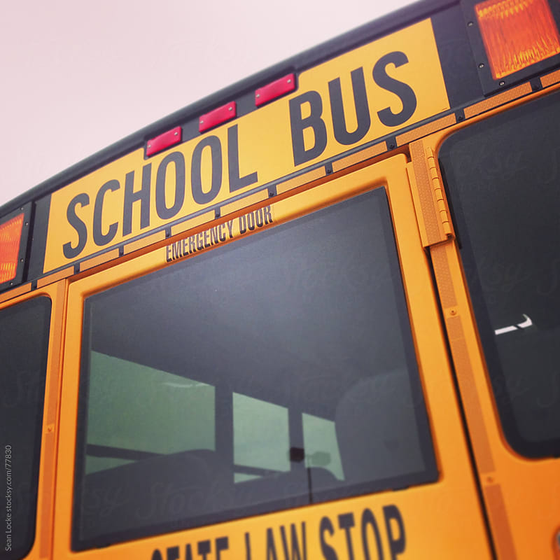 School Bus: Rear Door of School Bus by Sean Locke for Stocksy United