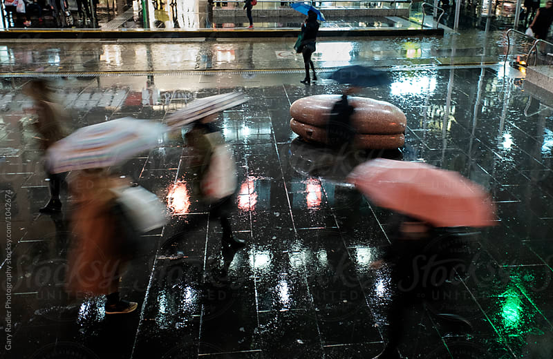 People with umbrellas on Bourke St Mall, Melbourne by Gary Radler Photography for Stocksy United