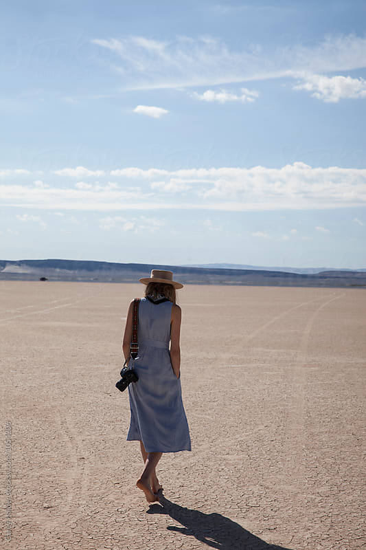 Female Photographer Tourist Walking In The Desert by Carey Haider for Stocksy United