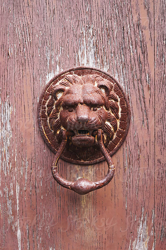 Rusty lionhead doorknocker by Marcel for Stocksy United