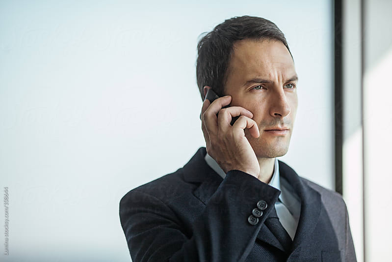 Businessman Making a Phone Call by Lumina for Stocksy United