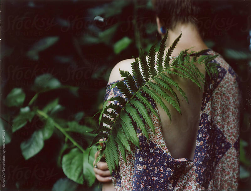 Girl with Fern. by Sarah VanTassel for Stocksy United