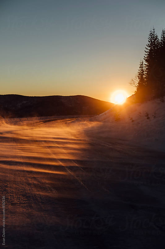 Windy Snow Covered Mountain Pass at Sunset by Evan Dalen for Stocksy United