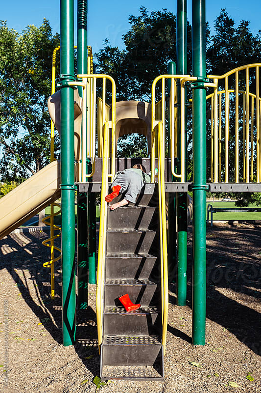 Little Boy Lost His Boot on the Playground by Gabrielle Lutze for Stocksy United
