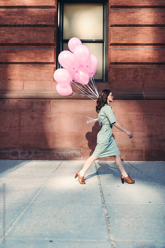 The girl with pink balloons by Cameron Whitman for Stocksy United