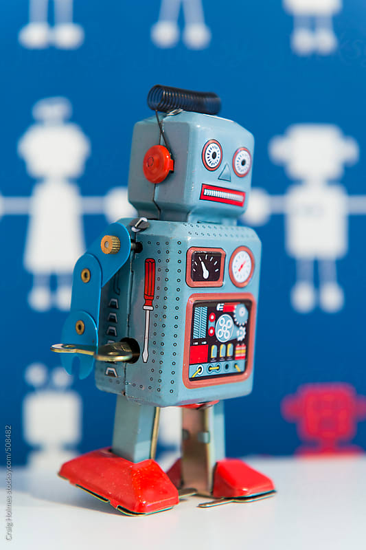 A vintage wind up toy robot, painted in blue and red by Craig Holmes for Stocksy United