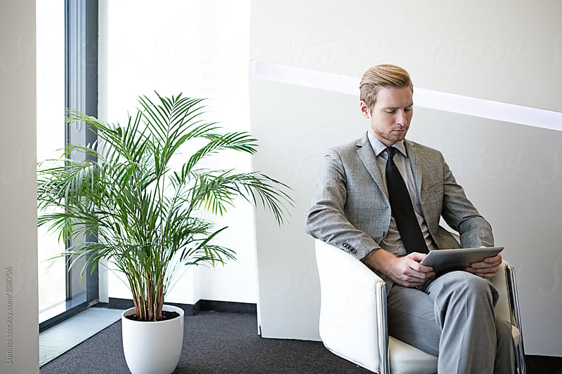 Young Businessman With a Tablet by Lumina for Stocksy United