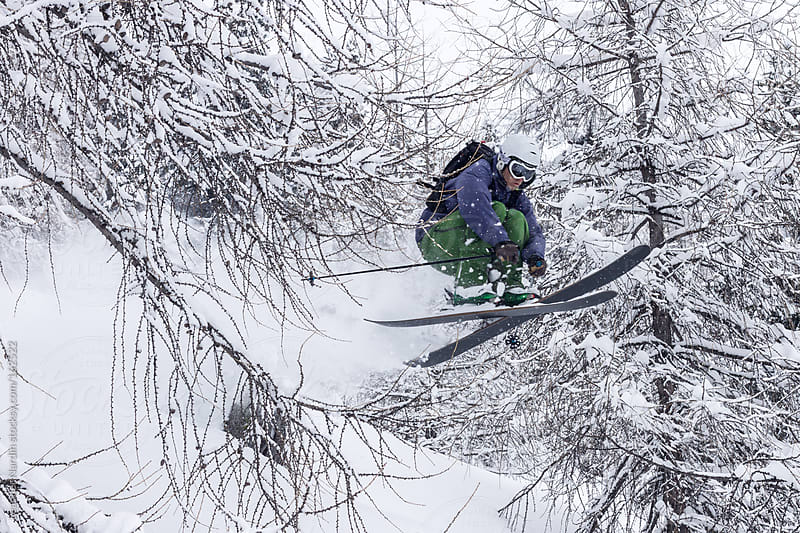 young male freerider skiing down a powder slope by Leander Nardin for Stocksy United
