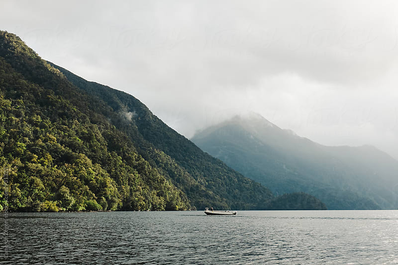 small boat in Doubtful Sound, New Zealand. by Cameron Zegers for Stocksy United