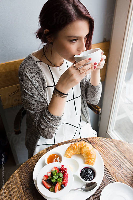 Young woman drinking a tea by Jovana Rikalo for Stocksy United