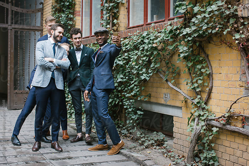 Five Stylishly Dressed Young Men Taking Selfie Outdoors by VISUALSPECTRUM for Stocksy United