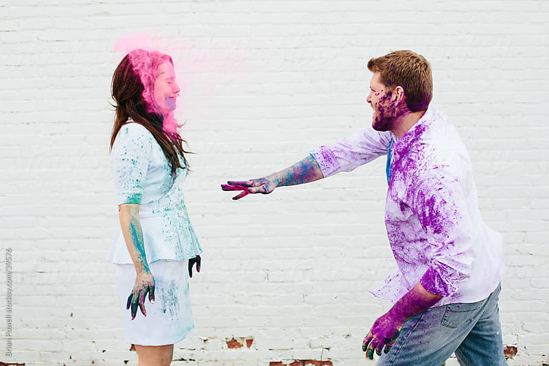 throwing Holi color in her face by Brian Powell for Stocksy United