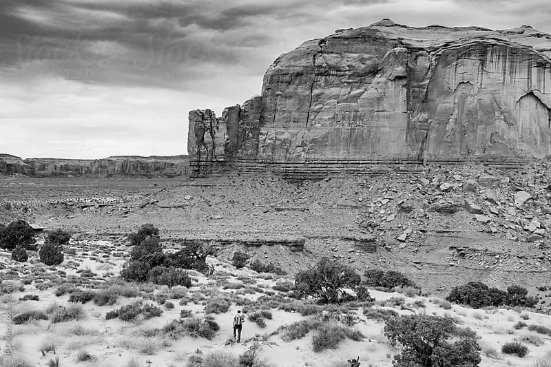 Aerial View of Man Hiking in Monument Valley Utah USA in Black and White by JP Danko for Stocksy United