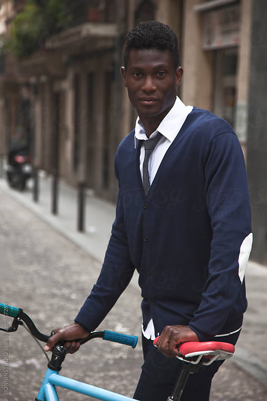 African young man with his bicycle by BONNINSTUDIO for Stocksy United