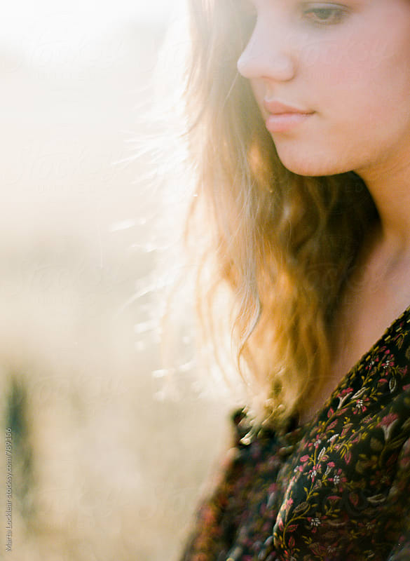 Girl in Autumn Light by Marta Locklear for Stocksy United
