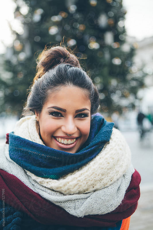 Portrait of a beautiful woman wearing many scarves by kkgas for Stocksy United