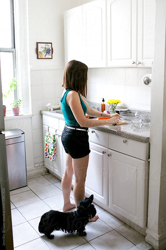 Woman cooking in kitchen  by Jennifer Brister for Stocksy United