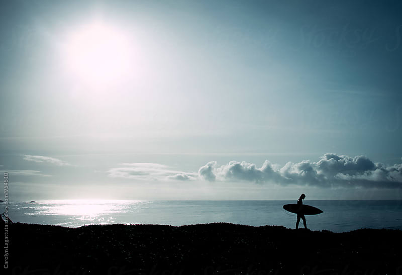Surfer headed to the ocean at dawn by Carolyn Lagattuta for Stocksy United