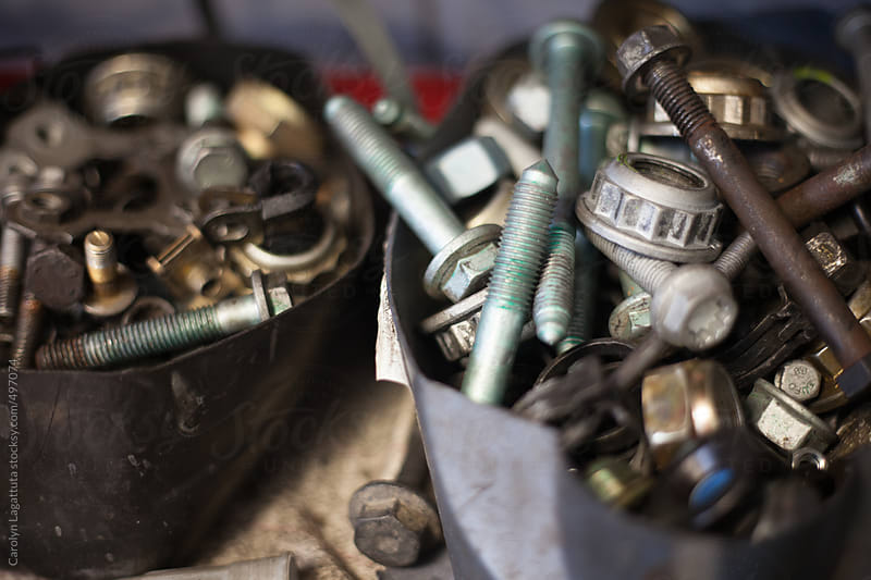Containers full of nuts and bolts in a repair shop by Carolyn Lagattuta for Stocksy United