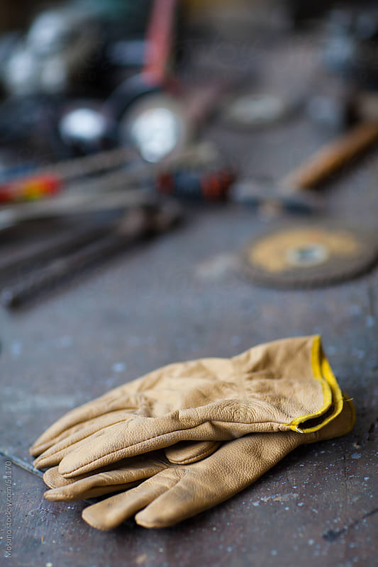 Protective gloves on the workshop table. by Mosuno for Stocksy United