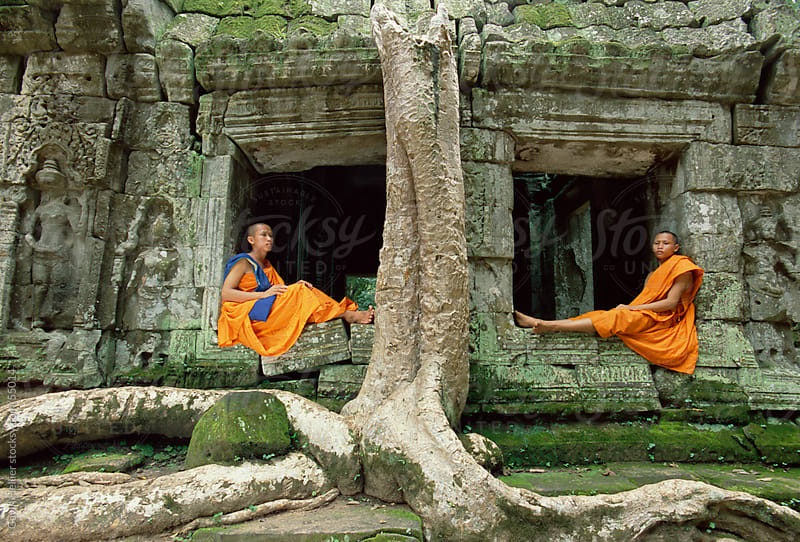 Monks in the Ta Prohm Temple, Angkor, UNESCO World Heritage Site, Siem Reap, Cambodia, Indochina, As by Gavin Hellier for Stocksy United