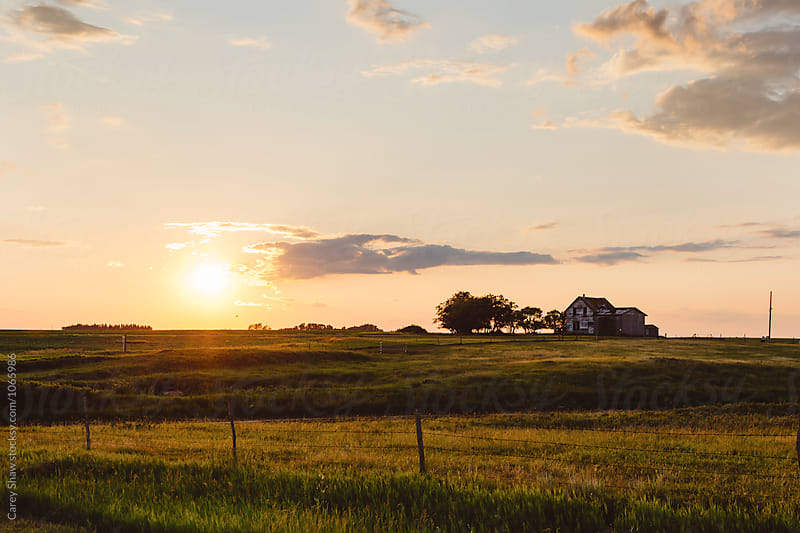 Landscape of old farm house at sunset by Carey Shaw for Stocksy United