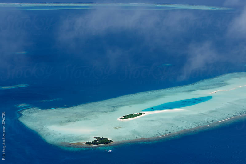 Maldivian Picnic Island by Felix Hug for Stocksy United