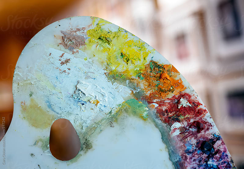 Artist's paint palette in the studio by Cara Dolan for Stocksy United