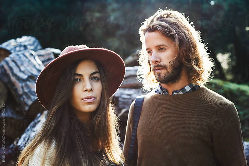 Portrait of a couple in a rural landscape. by BONNINSTUDIO for Stocksy United