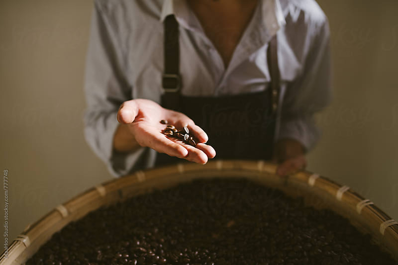 Man working at coffee roasting workshop by MaaHoo Studio for Stocksy United