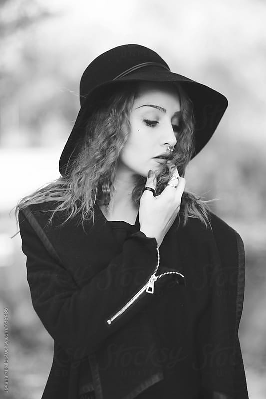 Black and white portrait of stylish young woman by Jovana Rikalo for Stocksy United
