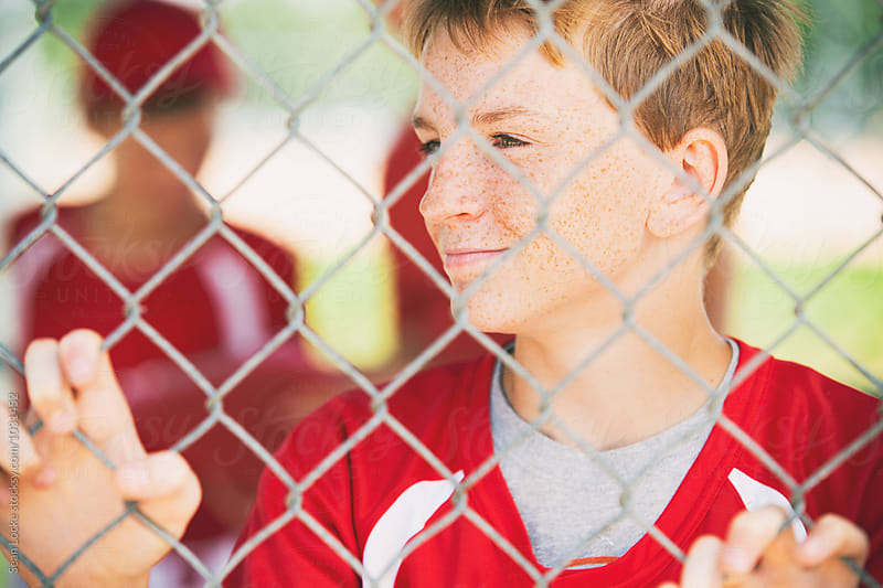 Baseball: Boy Player Waits For Turn To Bat In Dugout by Sean Locke for Stocksy United
