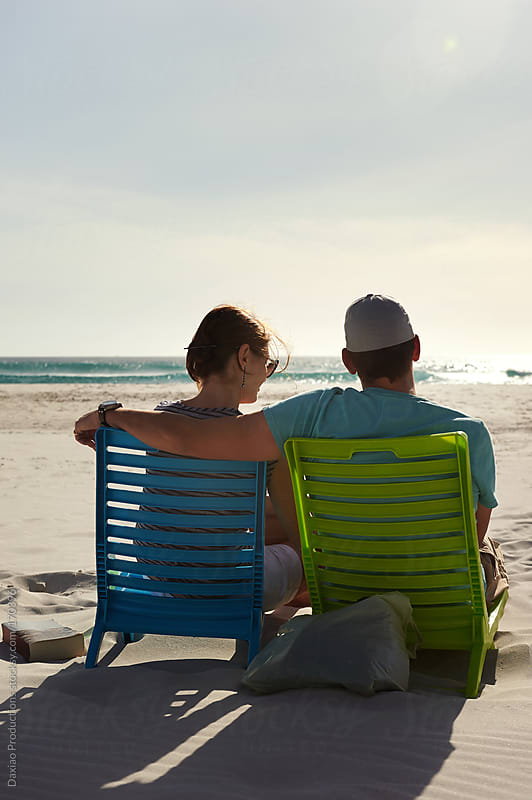 relaxed beach couple by Daxiao Productions for Stocksy United