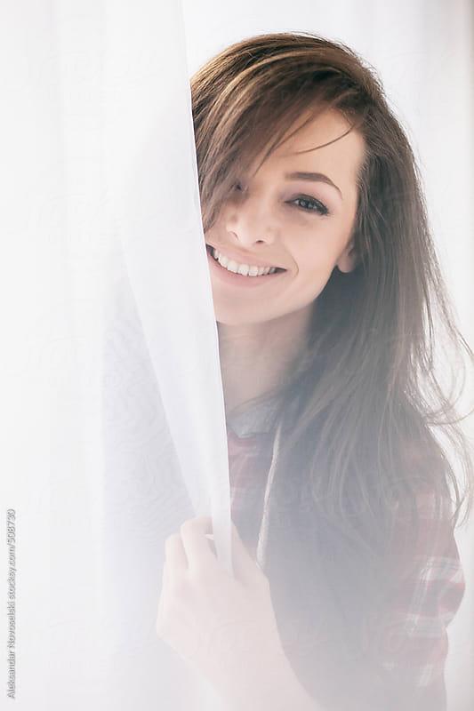 Cute girl smiling at camera by Aleksandar Novoselski for Stocksy United