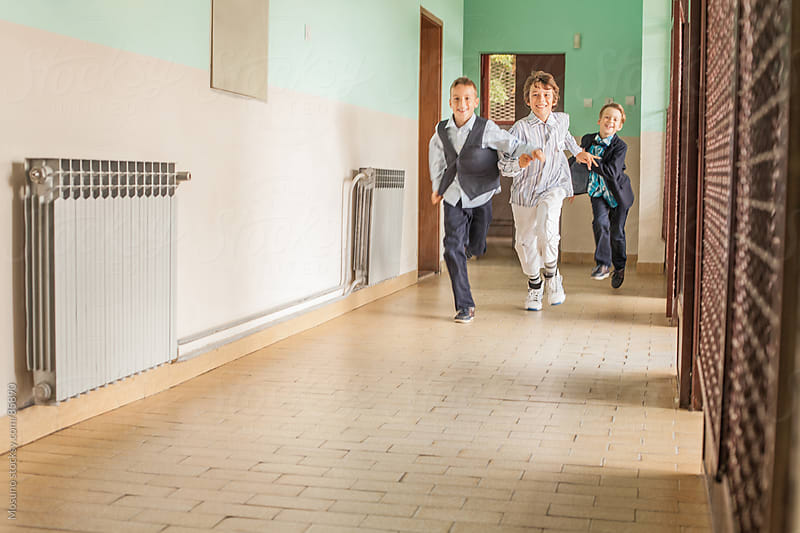 Schoolchildren Running Down the Hallway by Mosuno for Stocksy United