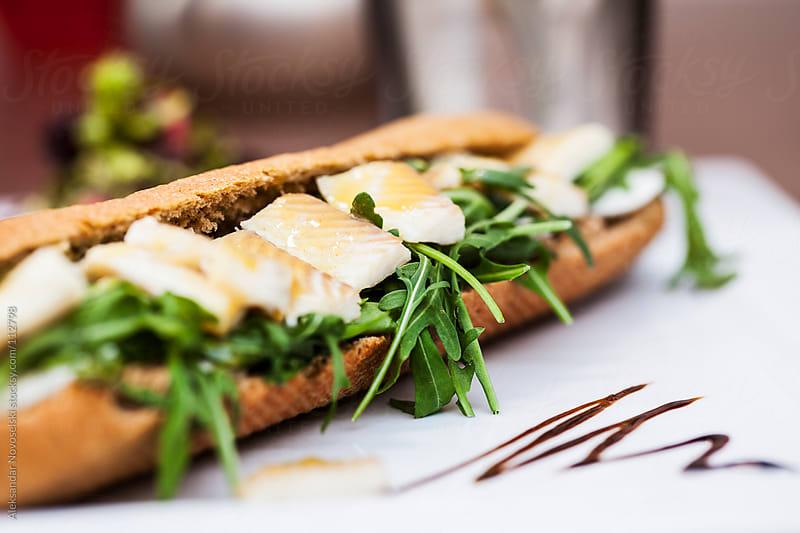 Sandwich with fish by Aleksandar Novoselski for Stocksy United