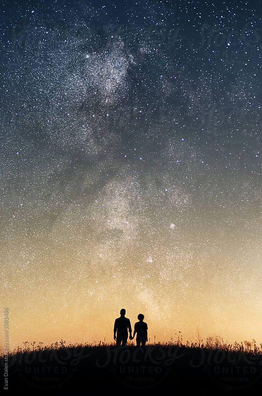 Couple Holding Hands Under Stars by Evan Dalen for Stocksy United