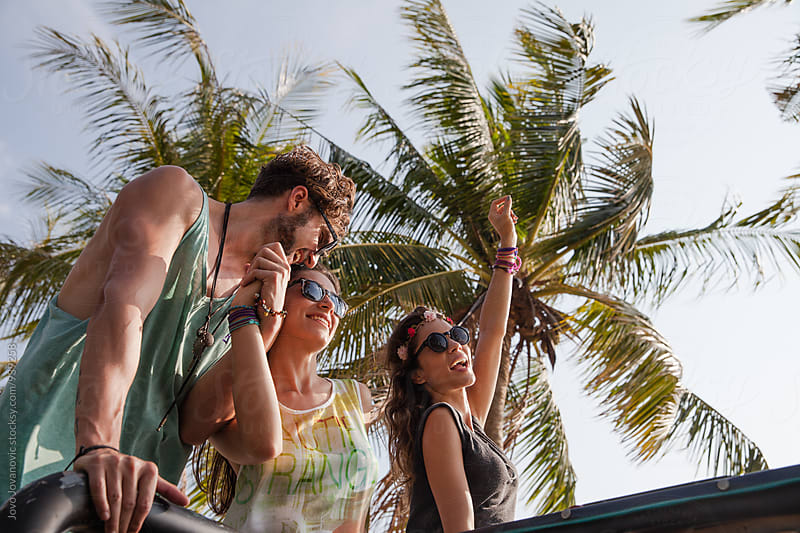 Summertime fun - group of friends at the tropical island by Jovo Jovanovic for Stocksy United