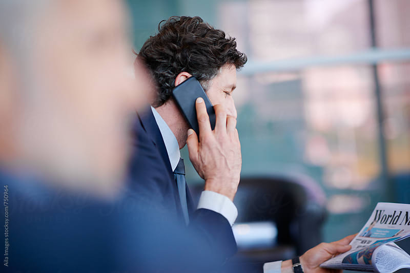 Mature Businessman talking on the phone by Aila Images for Stocksy United