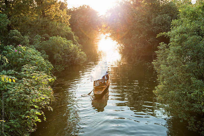 Boatride in Tranquil Waters (Hangzhou) by Andy Brandl for Stocksy United