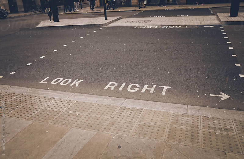 Look right symbol painted on the street by Leandro Crespi for Stocksy United