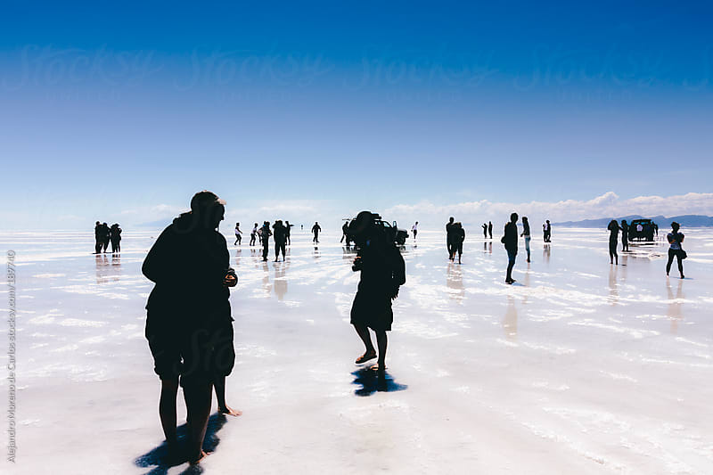 Group of people silhouette on Uyuni salt falt, Bolivia, South America by Alejandro Moreno de Carlos for Stocksy United