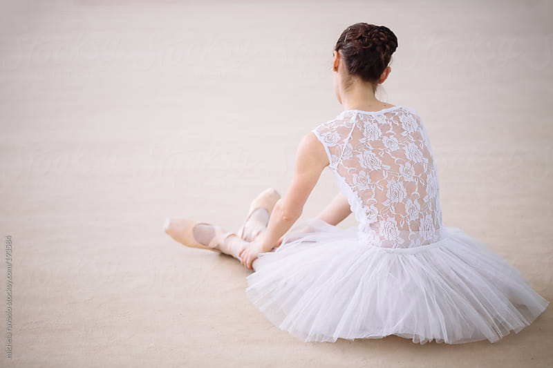 Ballet dancer resting on the floor by michela ravasio for Stocksy United
