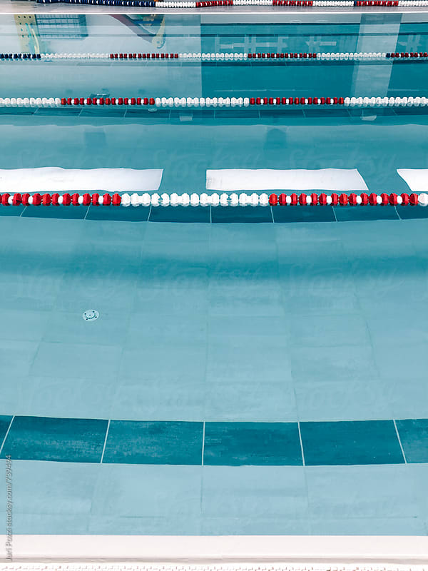 swimming pool in a gym by Juri Pozzi for Stocksy United