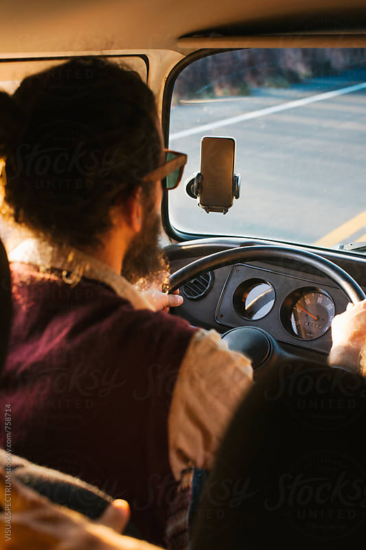 On The Road - Male Bearded Hippie Driving Camper Van by Julien L. Balmer for Stocksy United